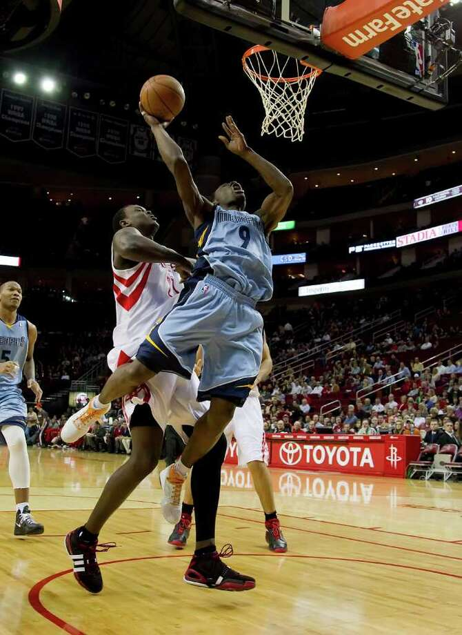 Tony Allen (9) of the Memphis Grizzlies goes for a shot in front of Samuel Dalembert (21) of the Houston Rockets in the first half on Monday, February 20, 2012, in Houston, Texas. (George Bridges/MCT) Photo: George Bridges, McClatchy-Tribune News Service / MCT
