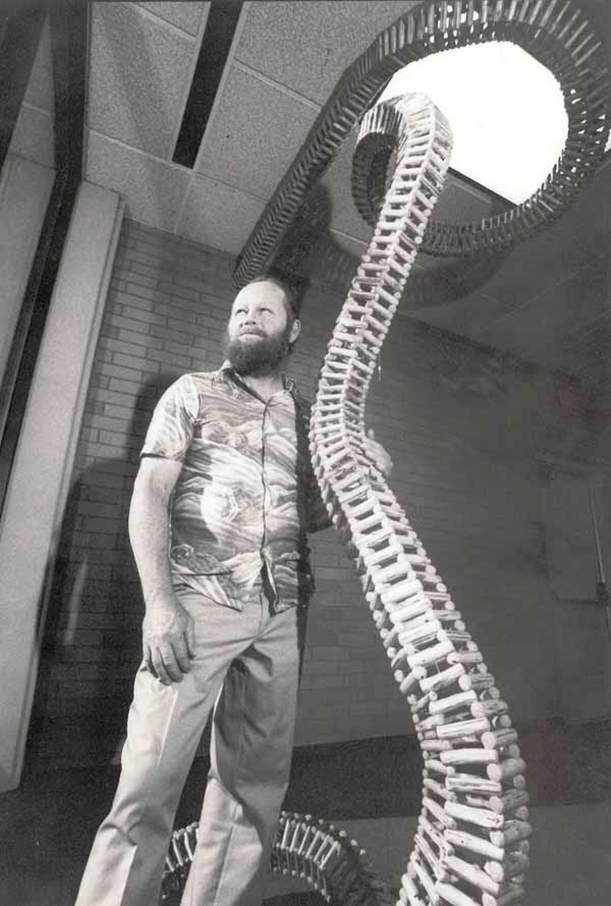 Charlie Stagg with one of his pieces that was displayed at the Jack Brooks Regional Airport in 1987. Enterprise file photo