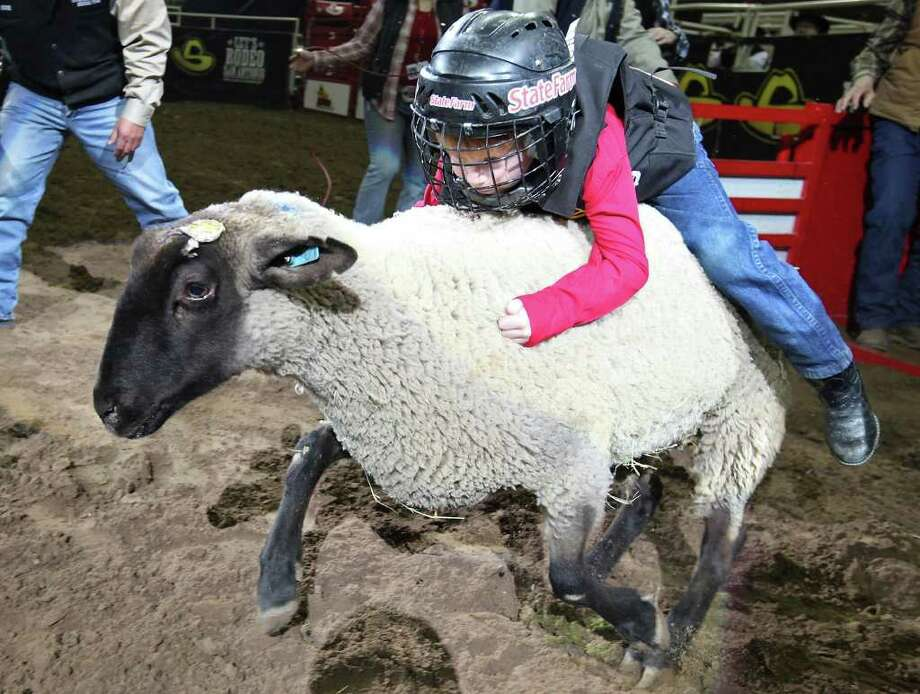 Watch the kids try to hang on in the Mutton Bustin' competition.   Photo: EDWARD A. ORNELAS, SAN ANTONIO EXPRESS-NEWS / © SAN ANTONIO EXPRESS-NEWS (NFS)