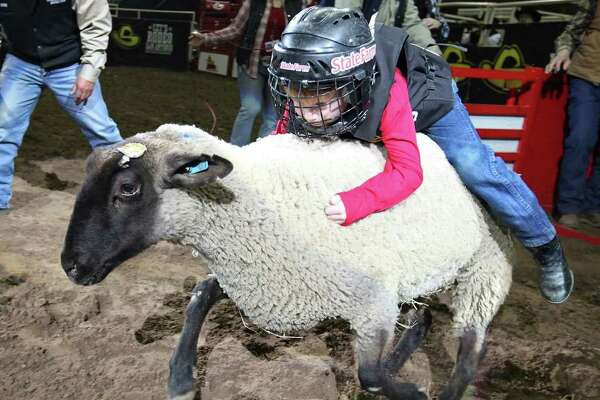 FOR METRO - Jeremiah Hokenson, 5, competes in the mutton bustin' event during the San Antonio Stock Show & Rodeo Monday Feb. 20, 2012 at the AT&T Center.