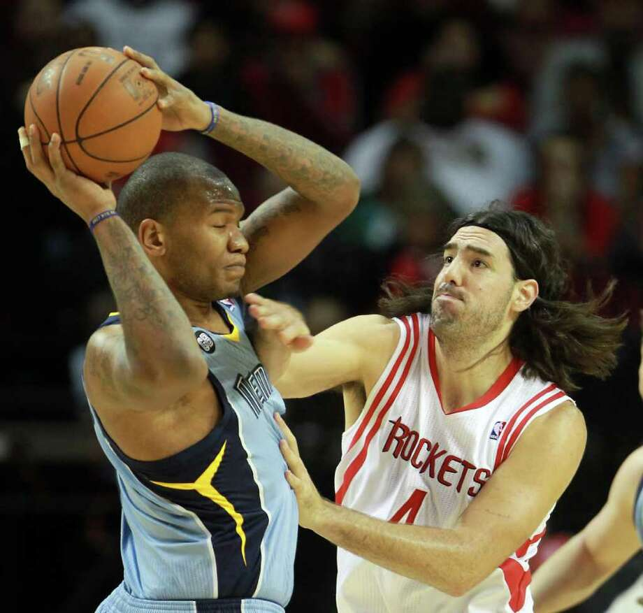Memphis Grizzlies center Marreese Speights (5) is fouled by Houston Rockets power forward Luis Scola (4) during the first quarter of a NBA basketball game, Monday, Feb. 20, 2012, in Toyota Center in Houston. Photo: Nick De La Torre, Houston Chronicle / © 2012  Houston Chronicle