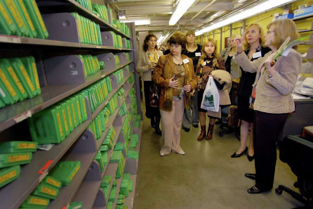 Times Union Staff Photo by Michael P. Farrell State Library Senior librarian Sharon Phillips (right) gives visiting librarians and educators from Albany's sister city Tula, Russia a tour of the Talking Book and Braille Library part of the State Library in Albany , New York 11/01/2006.