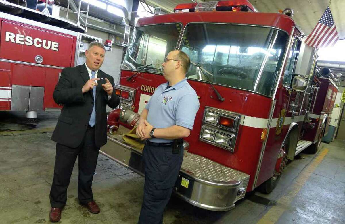 Cohoes Mayor John T. McDOnald ,left, and Fire Captain Wil Charbonneau talk about the possible merger of services with Watervliet at the Cohoes Fire Department in Cohoes, NY Wednesday May 4, 2011.( Michael P. Farrell/Times Union )