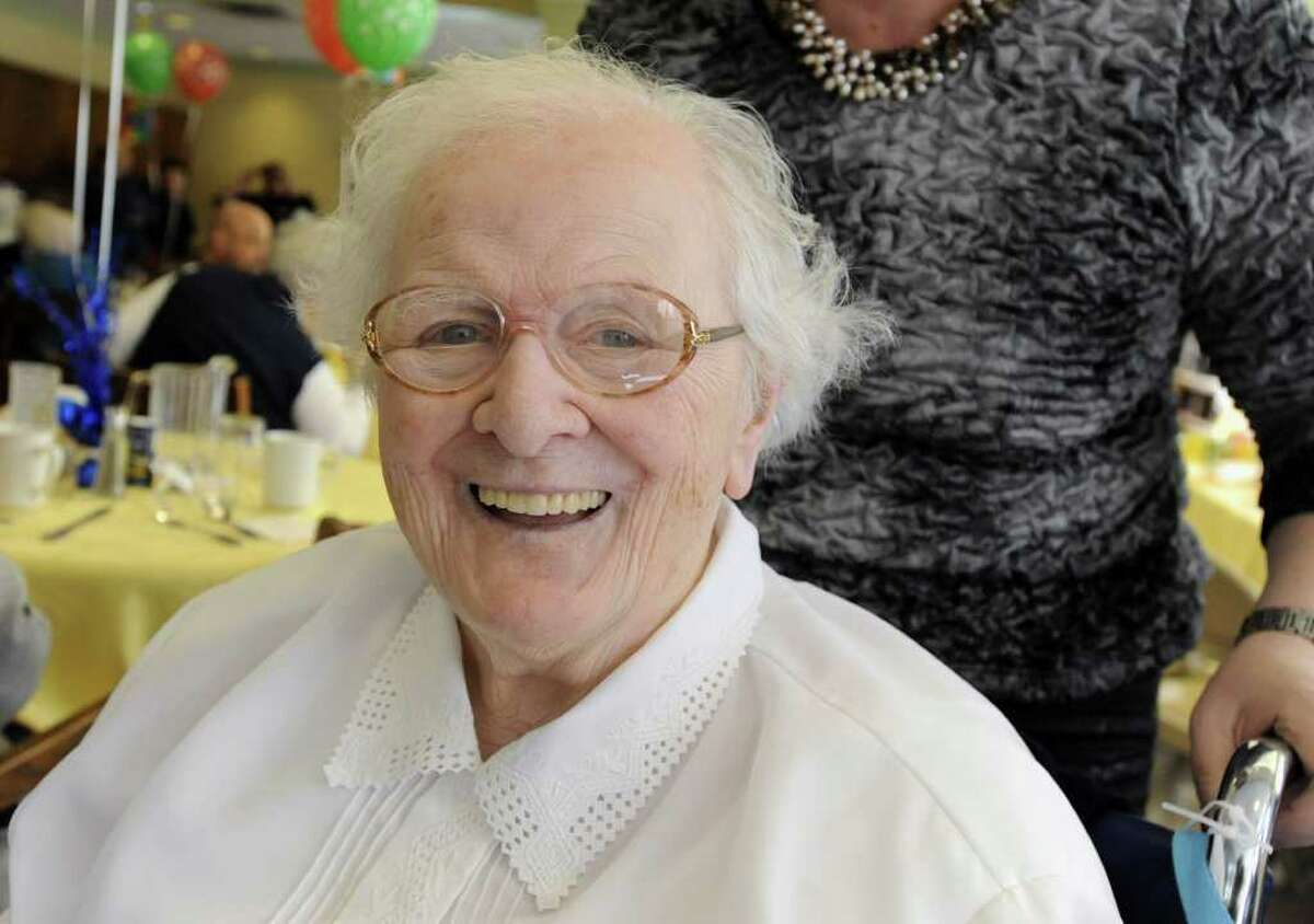 Sister Germaine Catlin smiles at her 100th birthday party at the St. Louise House on Monday, Feb. 20, 2012 in Menands, N.Y. Sister Gernaine was born on Feb. 20, 1912 in Troy. She is a retired elementary school teacher with the Daughters of Charity order. (Lori Van Buren / Times Union)