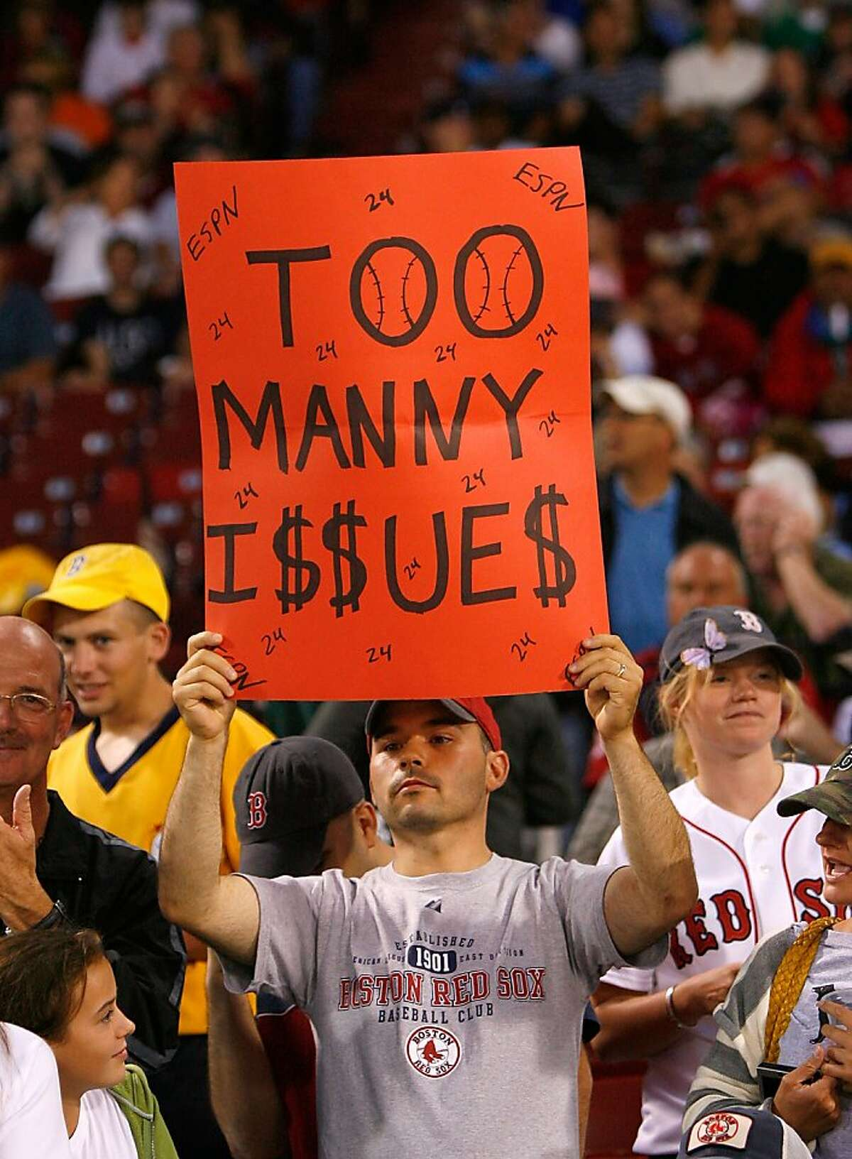 BOSTON - JULY 27: A fan show his displeasure with Manny Ramirez before a game between the New York Yankees and the Boston Red Sox at Fenway Park on July 27, 2008 in Boston, Massachusetts. (Photo by Jim Rogash/Getty Images)