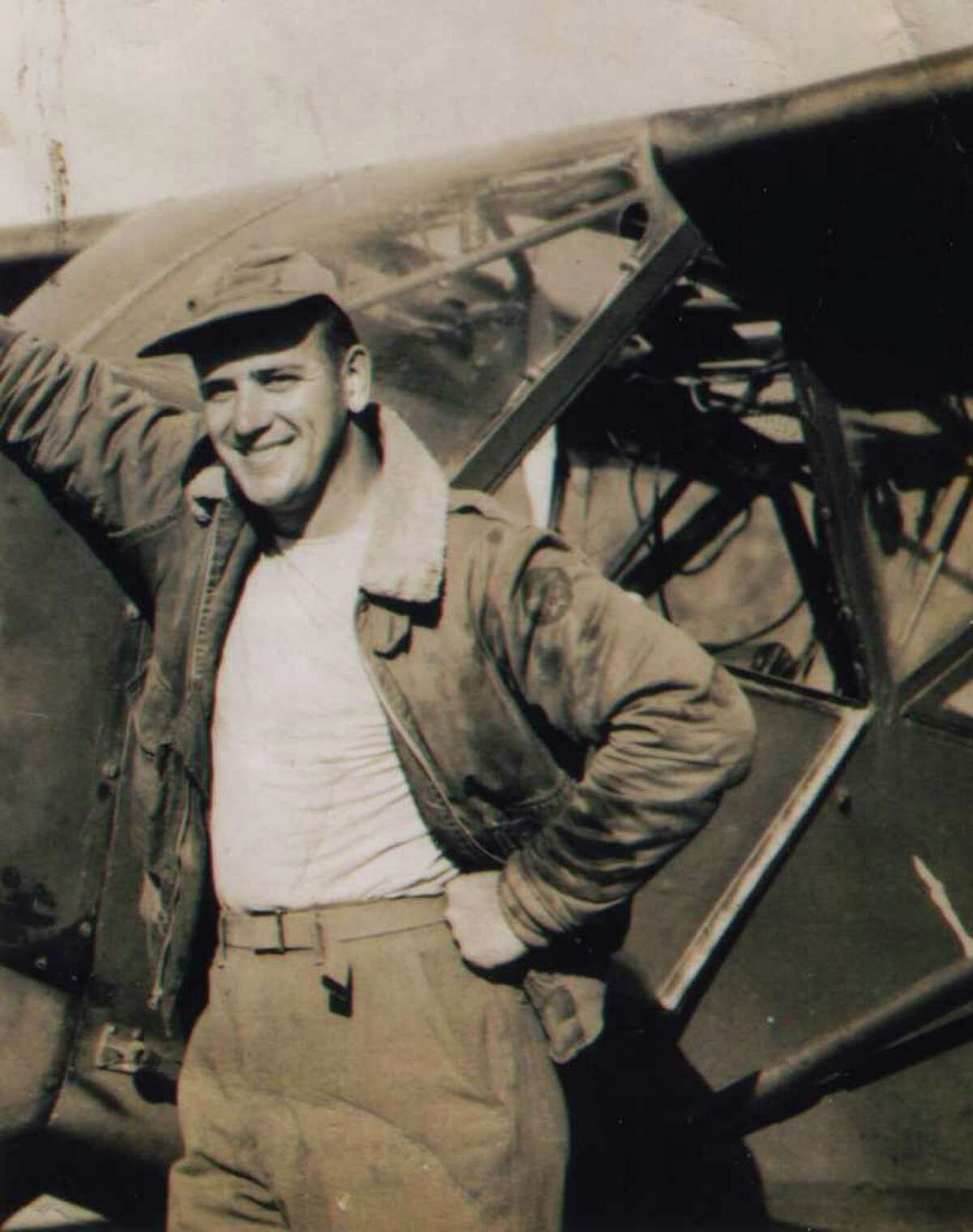 Ed With posses by his aircraft after returning from a mission in Burma, circa 1944. (Courtesy Ed With)
