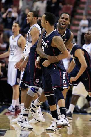 Connecticut's Alex Oriakhi, rear, celebrates with Shabazz Napier after Napier hit the game-winning 3-point shot against Villanova in overtime in an NCAA college basketball game Monday, Feb. 20, 2012, in Philadelphia. Connecticut won 73-70. (AP Photo/The Philadelphia Inquirer, Ron Cortes) PHIX OUT  NEWARK OUT  TV OUT   MAGS OUT   NO SALES Photo: Ron Cortes, Associated Press / Reprint