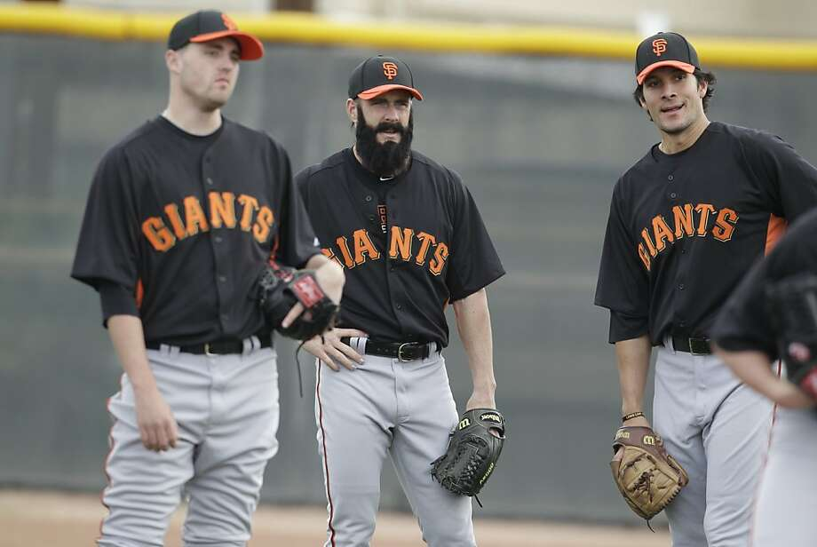 San Francisco Giants' Brian Wilson, middle, during a spring training baseball workout Sunday, Feb. 19, 2012, in Scottsdale, Ariz. (AP Photo/Darron Cummings) Photo: Darron Cummings, Associated Press
