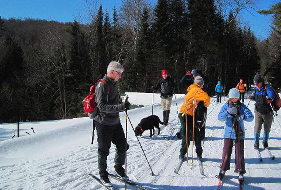 An Open House at Camp Santanoni in the Adirondacks, Monday Feb. 20, 2012, brought in a number of skiers including Dept. of Environmental Conservation Commissioner Joe Martens, left. (Rick Karlin / Times Union) Photo: Tutu