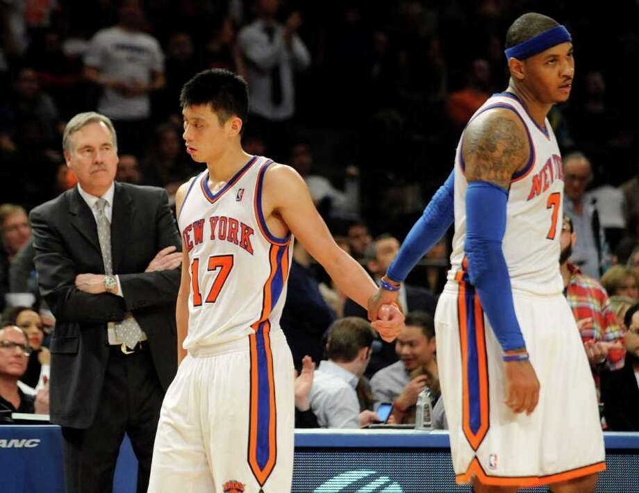 New York Knicks' Carmelo Anthony, right, holds Jeremy Lin's hand as he leaves the game after fouling out during the fourth quarter of an NBA basketball game against the New Jersey Nets, Monday, Feb. 20, 2012, at Madison Square Garden in New York. The Nets defeated the Knicks 100-92. Anthony shot 4 of 11 and scored 11 points. Lin finished with 21 points, nine assists and seven rebounds. Photo: AP