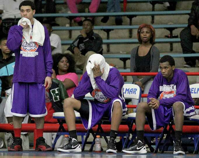 2/20/12: From left to right Josh Gray # 0 and Ruston Hayward # 1 and  Wheatley teammates sit on the