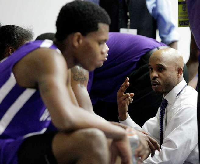 2/20/12: Wheatley Head coach Marshall Lyons III gives instructions during a timeout against Yates at