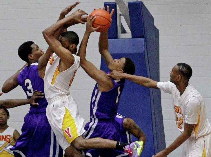 2/20/12: J.C. Washington # 5 of Yates is double teamed by Tavario Miller # 3 and Ruston Hayward # 1