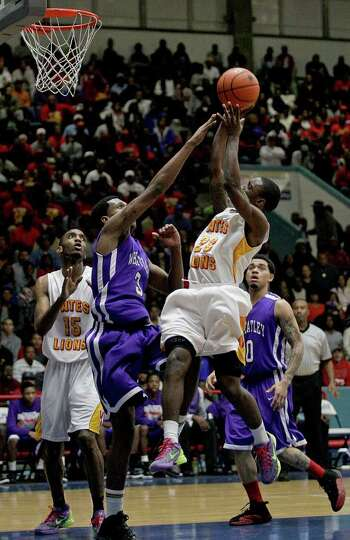 2/20/12: Darrion Martin # 23 of Yates shoots while Tavario Miller # 3 of Wheatley defends at Delmar