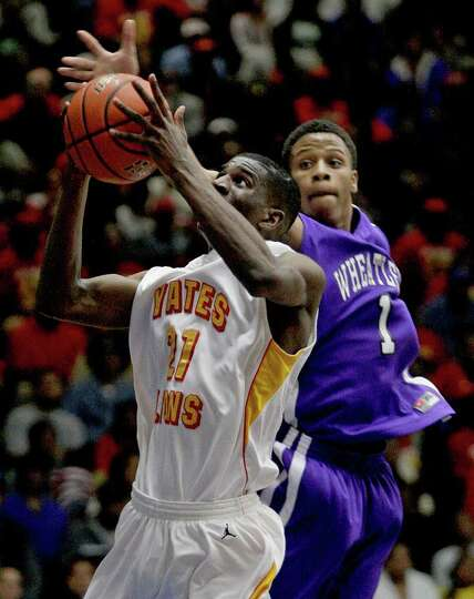 2/20/12: Damion Dotson # 21 of Yates handles the ball while  