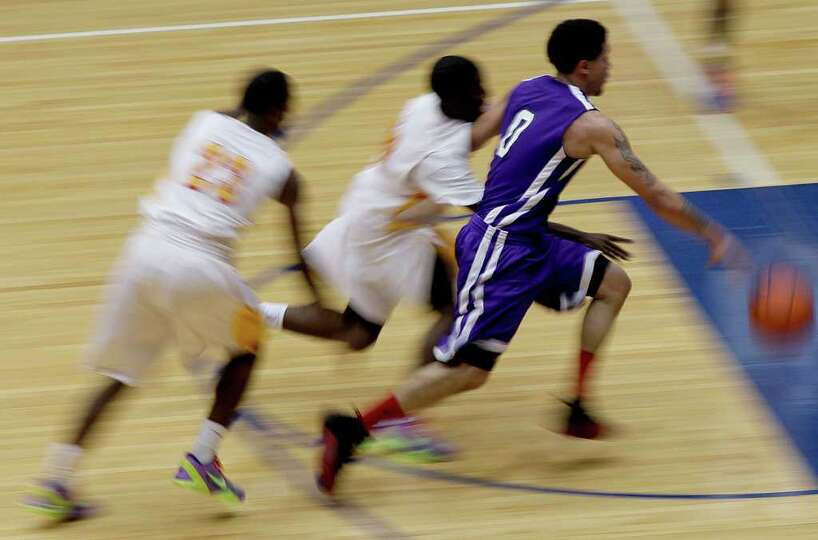 2/20/12: Josh Gray # 0 of Wheatley dribbles the ball down court as Yates defenders give chase at Del
