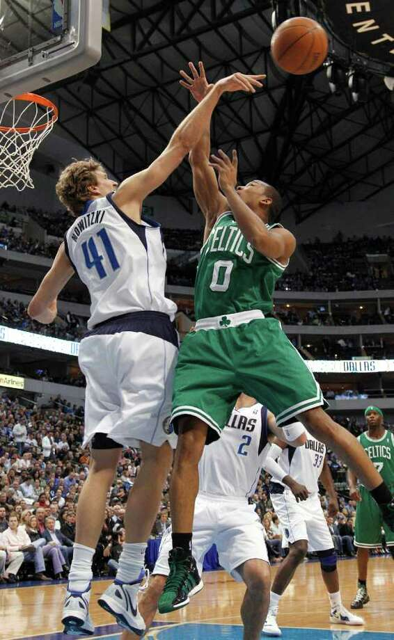 Dallas Mavericks forward Dirk Nowitzki (41), of Germany, blocks a shot by Boston Celtics guard Avery Bradley for his 1,000th career blocked shot, during the first half of an NBA basketball game in Dallas, Monday, Feb. 20, 2012. Photo: AP