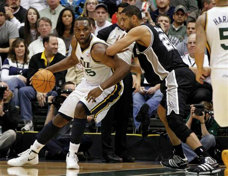 Jazz center Al Jefferson, left, is defended by Spurs center Tim Duncan (21) during the first half on a NBA basketball game Monday, Feb. 20, 2012, in Salt Lake City. (AP Photo/Jim Urquhart) (AP)