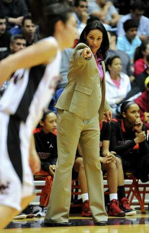 Wagner head coach Christina Camacho shouts instructions to her players during a UIL 5A girls third round playoff  basketball game between the Wagner T-Birds and the  Churchill Chargers at the UTSA Convocation Center In San Antonio, Texas on February 20, 2012.