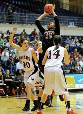 Wagner's Tesha Smith (30) takes a shot over Churchill's Rebecca Flores (40) during a UIL 5A girls third round playoff  basketball game between the Wagner T-Birds and the  Churchill Chargers at the UTSA Convocation Center In San Antonio, Texas on February 20, 2012.