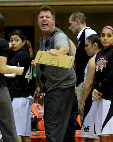 Churchill head coach Cal Wulfsberg shouts at the referee during a time out during a UIL 5A girls third round playoff  basketball game between the Wagner T-Birds and the  Churchill Chargers at the UTSA Convocation Center In San Antonio, Texas on February 20, 2012.