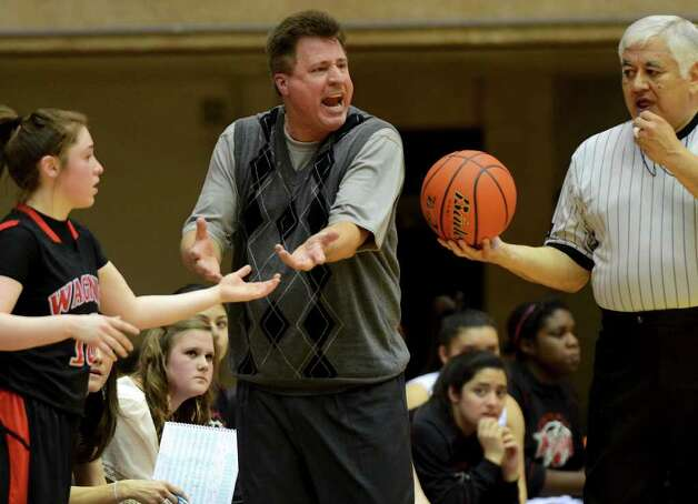 Churchill head coach Cal Wulfsberg argues with the referee during a UIL 5A girls third round playoff  basketball game between the Wagner T-Birds and the  Churchill Chargers at the UTSA Convocation Center In San Antonio, Texas on February 20, 2012.
