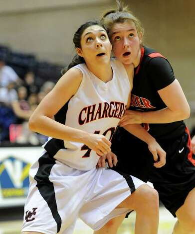Churchill's Rebecca Flores (40) blocks out Wagner's Corrina Moncada (10) during a UIL 5A girls third round playoff  basketball game between the Wagner T-Birds and the  Churchill Chargers at the UTSA Convocation Center In San Antonio, Texas on February 20, 2012.