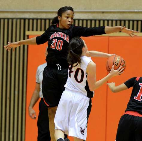 Wagner's Tesha Smith (30) tries to block the shot of Churchill's Rebecca Flores (40) during a UIL 5A girls third round playoff  basketball game between the Wagner T-Birds and the  Churchill Chargers at the UTSA Convocation Center In San Antonio, Texas on February 20, 2012.