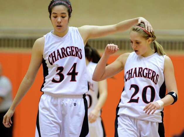 Churchill's Danielle Espinoza (34) consoles her teammate Leslie Vorpahl (20) near the end of the UIL 5A girls third round playoff  basketball game between the Wagner T-Birds and the  Churchill Chargers at the UTSA Convocation Center In San Antonio, Texas on February 20, 2012.