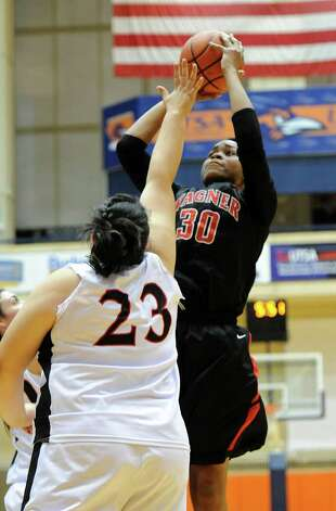 Wagner's Tesha Smith (30) takes a shot during a UIL 5A girls third round playoff  basketball game between the Wagner T-Birds and the  Churchill Chargers at the UTSA Convocation Center In San Antonio, Texas on February 20, 2012.