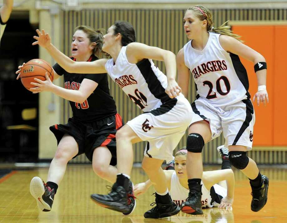 Wagner's Corrina Moncada (10) grabs a loose ball away from Churchill's Rebecca Flores (40) and Leslie Vorpahl (20) during a UIL 5A girls third round playoff  basketball game between the Wagner T-Birds and the  Churchill Chargers at the UTSA Convocation Center In San Antonio, Texas on February 20, 2012.