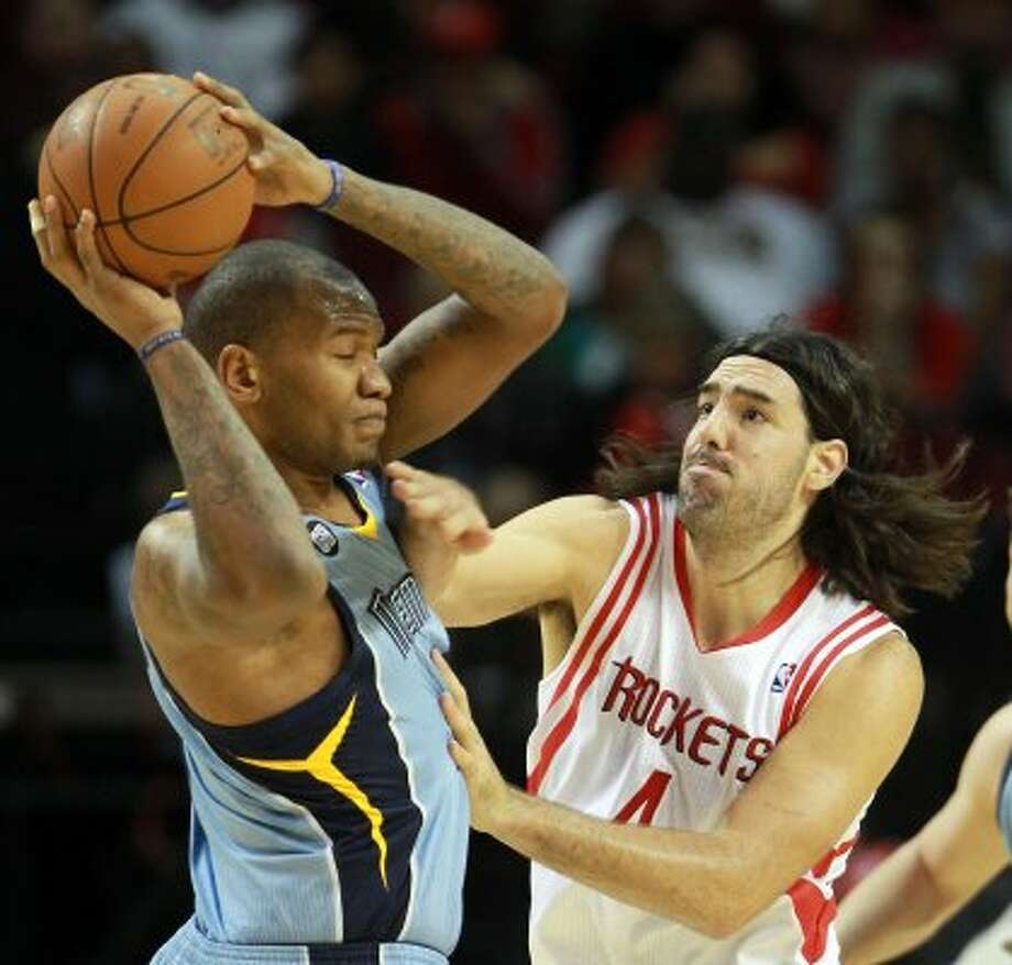 Grizzlies center Marreese Speights (5) is fouled by Rockets power forward Luis Scola (4) during the first quarter. (Nick de la Torre / Houston Chronicle)