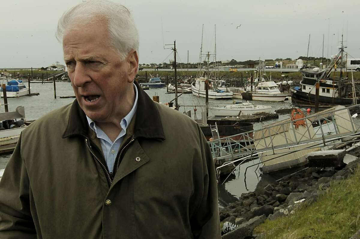 Rep. Mike Thompson surveys damage Saturday at the Crescent City Harbor, which sustained the most damage of any harbor along the California coast after the Japan earthquake triggered a tsunami.