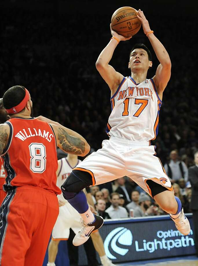 New York Knicks' Jeremy Lin (17) puts up a shot as New Jersey Nets' Deron Williams looks on during the first quarter of an NBA basketball game, Monday, Feb. 20, 2012, at Madison Square Garden in New York.  (AP Photo/Bill Kostroun) Photo: Bill Kostroun, Associated Press