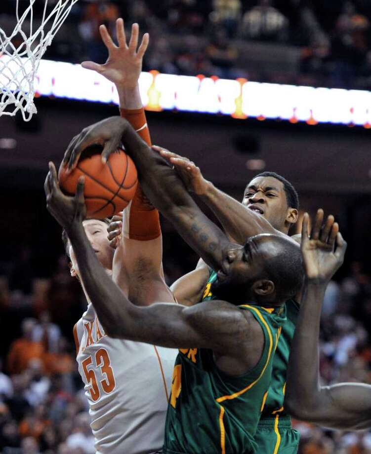 Baylor's Quincy Acy, right front, fights for one of his 16 rebounds against Texas' Clint Chapman, left, in the first half. Acy also scored 22 points. Photo: Michael Thomas / FR65778 AP