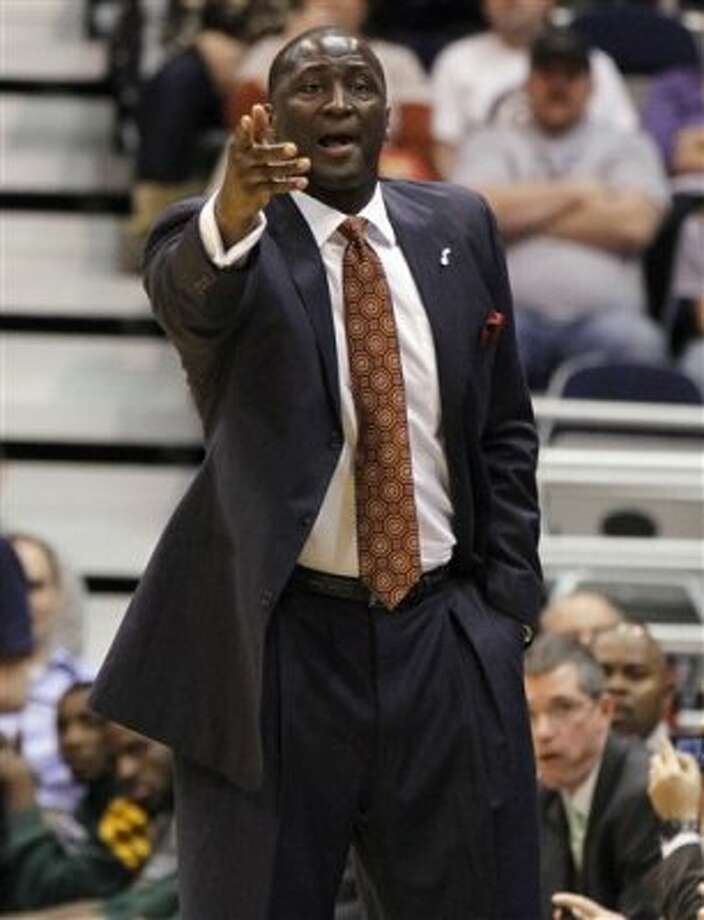 Utah Jazz head coach Tyrone Corbin argues a call during the first half on a NBA basketball game, Monday, Feb. 20, 2012, in Salt Lake City. The Spurs won 106-102. (AP Photo/Jim Urquhart) (AP)