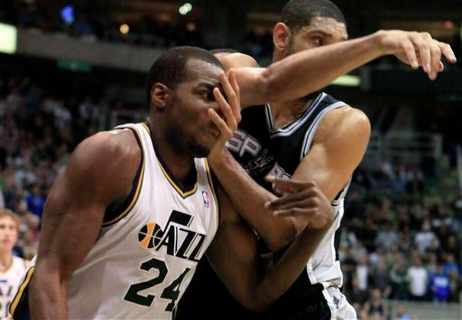 Utah Jazz forward Paul Millsap (24) and San Antonio Spurs center Tim Duncan (21) jockey for position during the second half on a NBA basketball game, Monday, Feb. 20, 2012, in Salt Lake City. The Spurs won 106-102. (AP Photo/Jim Urquhart) (AP)