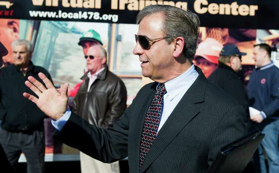 Joe Carbone, President and CEO of the WorkPlace, on hand as Congressmen Jim Himes and Chris Murphy hold a press conference in Westport, Conn., February 20, 2012 , to discuss the need to invest in transportation infrastructure. The press conference was held in a commuter lot off of I-95 on Saugatuck Avenue, the highway crosses over the avenue by way of  a structurally deficient bridge. Photo: Keelin Daly / Stamford Advocate