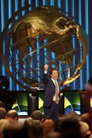 Lakewood Church Pastor Joel Osteen,welcoms his congregation to his 11 a.m. service, Sunday, Aug. 28, 2011, in Houston. Olsteen's church averages about 40,000 people in attendance per week. Photo: Nick De La Torre, Houston Chronicle / © 2010 Houston Chronicle