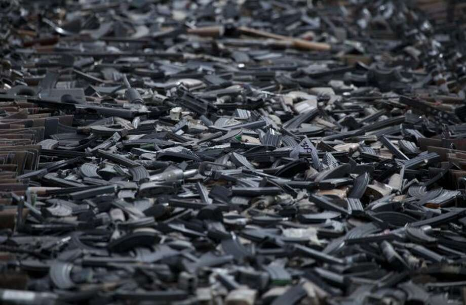 Seized firearms stacked before being destroyed by the army in Ciudad Juarez, Mexico (AP Photo/Eduardo Verdugo)