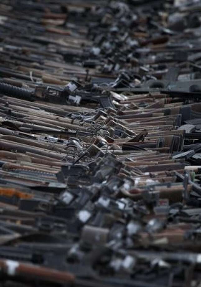 Seized firearms are seen stacked before being destroyed by the Mexican army in Ciudad Juarez, Mexico. (AP Photo/Eduardo Verdugo)