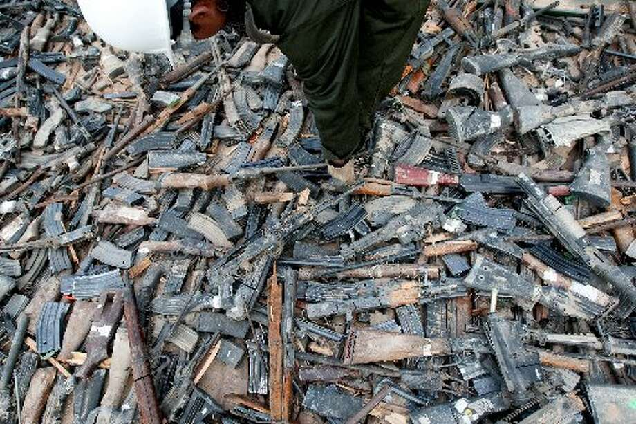 Thousands of guns lie on the ground before their destruction in Ciudad Juarez, on February 16. At least 6000 rifles and pistols were destroyed by members of the Mexican Army. (Jesus Alcazar/AFP/Getty Images)