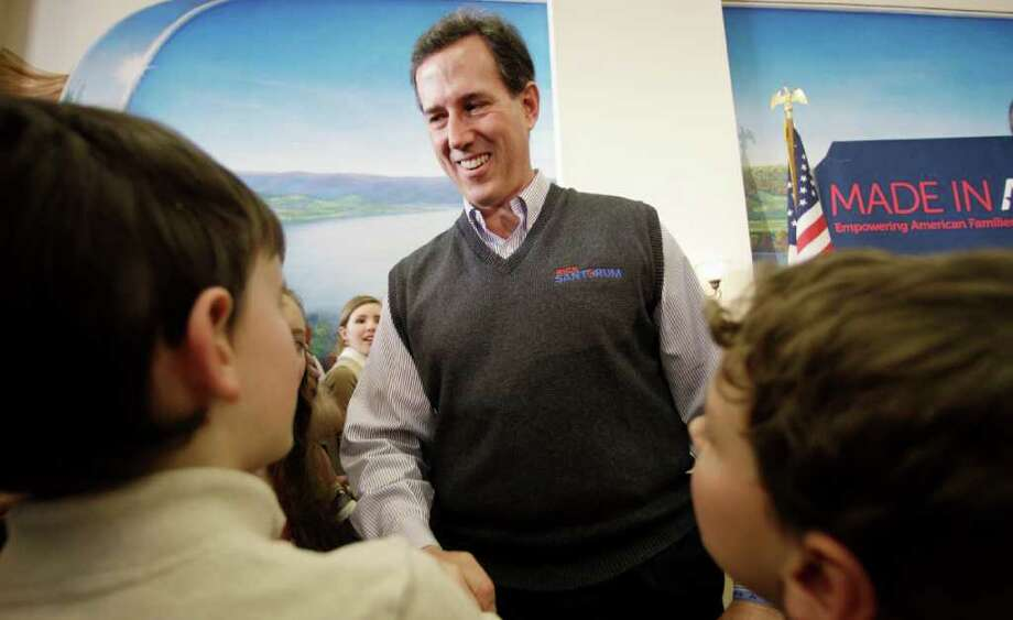 While Republican presidential candidate Rick Santorum campaigns in Ohio,  some GOP insiders — worried about his stance on social issues  — are looking for an alternative. Photo: Eric Gay, Associated Press