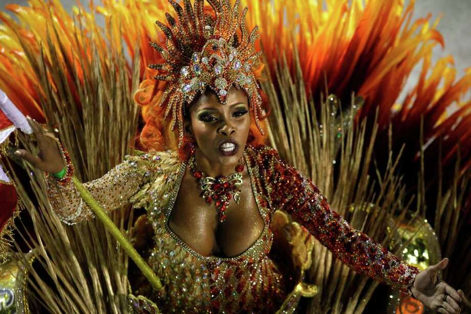 A dancer of Grande Rio samba school parades during carnival celebrations at the Sambadrome in Rio de Janeiro, Brazil, Tuesday. Nearly 100,000 paying spectators turn out for the all-night spectacle at the Sambadrome. Photo: AP