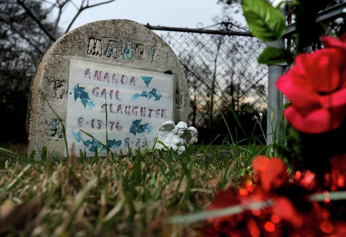 Brenda Slaughter has covered a gravestone for MANDY, WIFE-MOTHER with the name of her daughter, Amanda Gail Slaughter. Mandy's daughter Merideth Menard stuck the white angel figurine in the ground several years ago. Guiseppe Barranco/The Enterprise