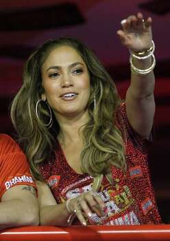 Jennifer Lopez greets people as she watches the carnival parade at the Sambadrome in Rio de Janeiro, Brazil, Sunday Feb. 19, 2012. (AP Photo/Victor R. Caivano) Photo: Victor R. Caivano / AP