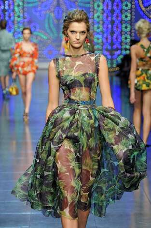 This dress is from the 2012 spring/summer ready-to-wear Dolce & Gabbana collection, which featured prints, many in florals and is reminiscent of an updated 1960s look that was seen in the Oscar nominated film The Help. / The Help
