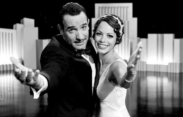Jean Dujardin as George Valentin and Berenice Bejo as Peppy Miller in Michel Hazanavicius's film THE ARTIST