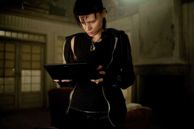 "In this film image released by Sony Pictures, Rooney Mara is shown in a scene from ""The Girl With The Dragon Tattoo."" (AP Photo/Sony, Columbia Pictures, Merrick Morton) Photo: Merrick Morton, HONS / © 2011 Columbia TriStar Marketing Group, Inc. All Rights Reserved."