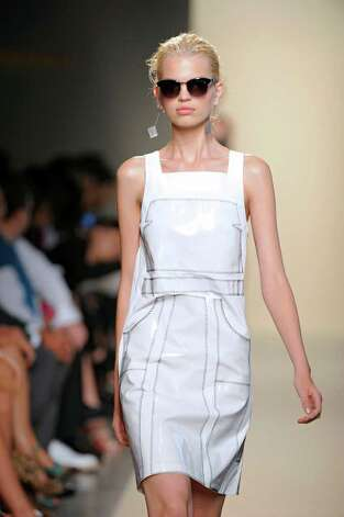 A white dress by Bottega Veneta, worn with dark sunglasses, evokes a look from the film My Week With Marilyn. / Bottega Veneta